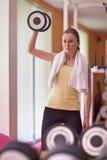 Woman lifting weight Stock Photos
