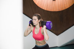 Woman lifting weight in the gym. Young woman lifting weight in the gym Stock Photography