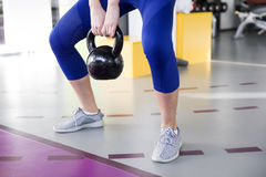 Woman lifting weight in the gym. Young woman lifting weight in the gym Stock Photo