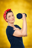 Woman lifting weight rosie riveter Royalty Free Stock Photo