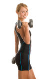 Woman exercising with weights Stock Images