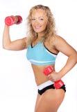Woman lifting weights Royalty Free Stock Image