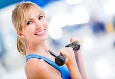 Woman lifting weights Royalty Free Stock Photos