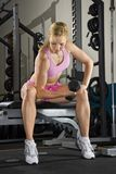 Woman lifting weights. Stock Images