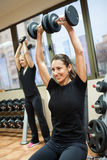 Woman with lifting weights Stock Images
