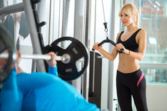 Woman lifting weights in gym club Stock Image