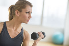 Woman Lifting Weights At Health Club Stock Photos