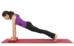 Woman lifting weights in plank pose Stock Images
