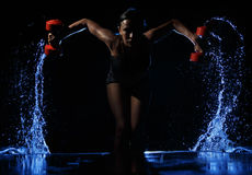 Woman Lifting Weights. Workout posture in water royalty free stock photo