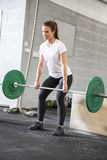 Woman lifts deadlift at the fitness gym Stock Photography