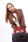 Woman lifts a heavy suitcase Royalty Free Stock Photography