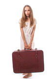 Woman lifts a heavy suitcase, isolated on white Stock Images