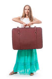 Woman lifts a heavy suitcase, isolated on white Stock Photography