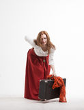 Woman lifts a heavy suitcase Royalty Free Stock Photos