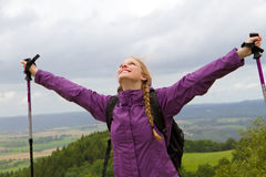 Woman lifts her arms Royalty Free Stock Photography