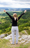 Woman lifts her arms Stock Photo