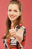 Woman lifts thumb upwards as sign Royalty Free Stock Photos