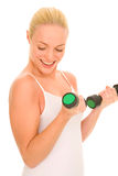 Woman lifts weights Royalty Free Stock Photos