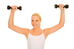 Woman lifts weights Royalty Free Stock Photography