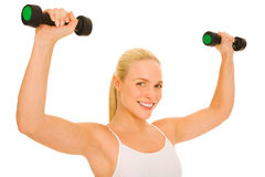Woman lifts weights Royalty Free Stock Images