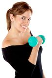 Woman liftying a free weight Stock Photo