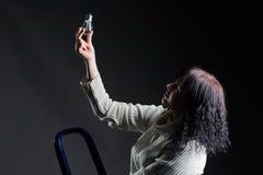 Woman and light bulb Stock Photos