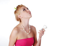 Woman with light bulb Stock Image