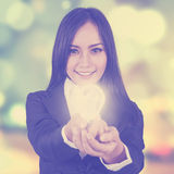 Woman with light bulb and blur background Royalty Free Stock Photos