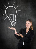 Woman with a light bulb royalty free stock photos