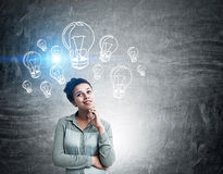 Woman with light bulb sketches Royalty Free Stock Images