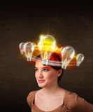 Woman with light bulbs circleing around her head Stock Images