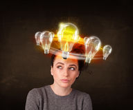 Woman with light bulbs circleing around her head Royalty Free Stock Photography