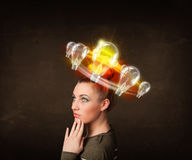Woman with light bulbs circleing around her head Stock Photo