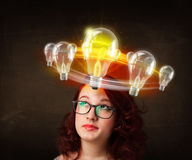Woman with light bulbs circleing around her head Royalty Free Stock Photo