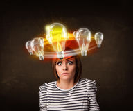 Woman with light bulbs circleing around her head Stock Image