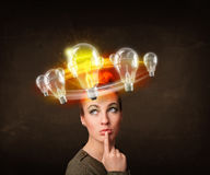 Woman with light bulbs circleing around her head Stock Photography
