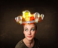 Woman with light bulbs circleing around her head Royalty Free Stock Images