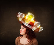 Woman with light bulbs circleing around her head Stock Photos