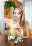 Woman with light bulbs at home Royalty Free Stock Image