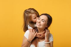 Woman in light clothes have fun with cute child baby girl 4-5 years old. Mommy little kid daughter  on yellow