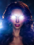 Woman with light from eyes Stock Photo