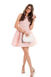 Woman in light pink dress. Stock Image