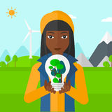 Woman with lightbulb and trees inside. Royalty Free Stock Image
