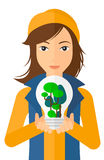 Woman with lightbulb and trees inside Stock Photo