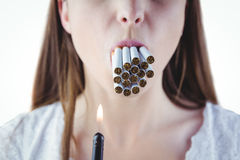 Woman lighting many cigarettes in mouth Stock Photos