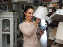 Woman in lighting shop Royalty Free Stock Photography