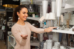 Woman in lighting shop Royalty Free Stock Image