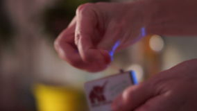 Woman Lights a Match. Close up of hands lighting a match.A match is a tool for starting a fire. There are two main types of matches: safety matches, which can be stock footage