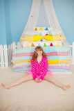 Woman like a doll in a nursery Royalty Free Stock Photography