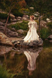 A woman like a princess in an vintage dress. In fairy park Royalty Free Stock Image